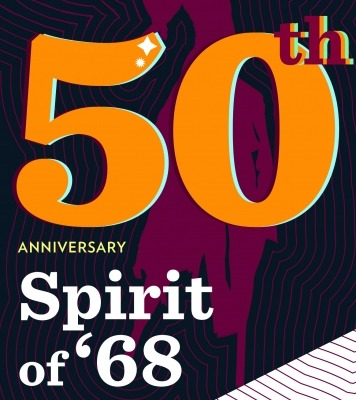 "The words ""50th Anniversary Spirit of '68"" in orange and white in front of a purple background"