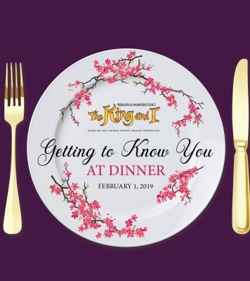 """White plate with a purple background and golden fork and knife next to the plate. Cherry blossoms decorate the plate and the words """"Getting to know you at dinner"""" are written on the plate."""