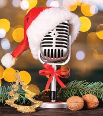 Microphone with a santa hat in front of a gold and brown background