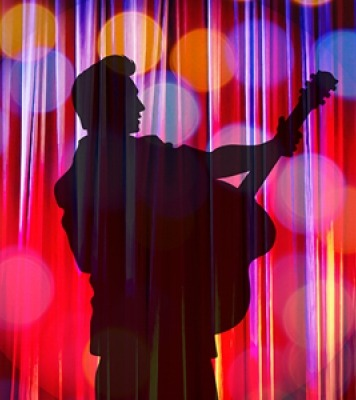 Black Elvis silhouette in front of a pink, blue, and orange background