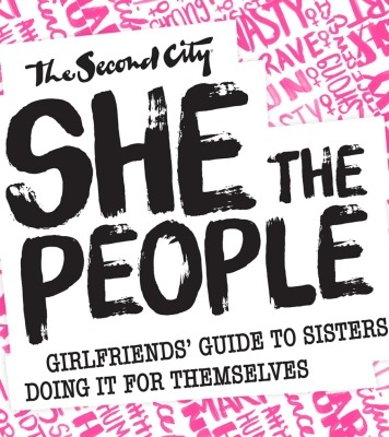 "The words ""The Second City She the People Girlfriends' Guide to sisters doing it for themselves"" in black in front of a pink background."