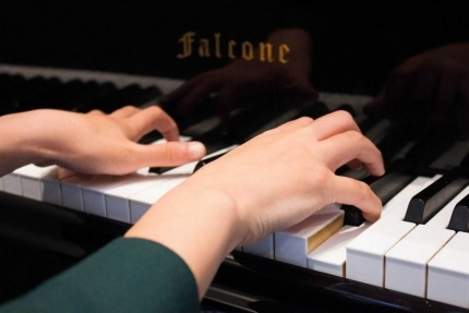Image of hands playing piano