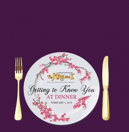 "White plate with a purple background and golden fork and knife next to the plate. Cherry blossoms decorate the plate and the words ""Getting to know you at dinner"" are written on the plate."
