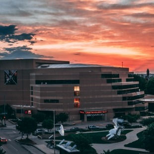 Exterior photo of the Lied Center at sunset