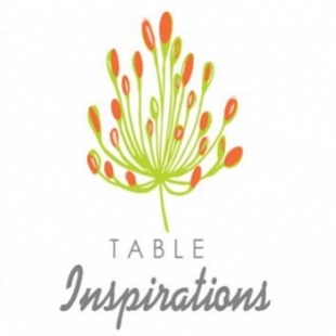 """A green clip art plant with orange bulbs and the words """"table inspirations"""" written under it."""