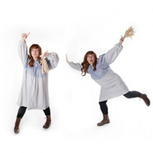 two ladies dressed as pioneers dancing on white background