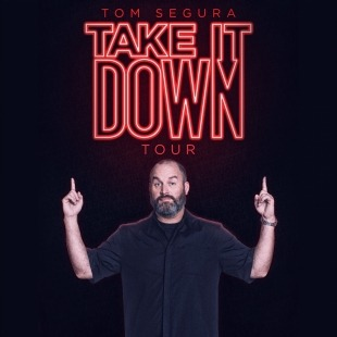 "Tom Segura in a black T-shirt in pointing up to the words ""TOM SEGURA TAKE IT DOWN TOUR"" in red neon in front of a black background."