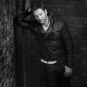 Black and white photo of Harry Connick Jr wearing a black leather jacket
