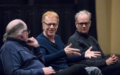 Image of Danny Elfman, a Lincoln art critic, and a UNL faculty member seated next to each other and engaged in discussion during a Lied Center master class.