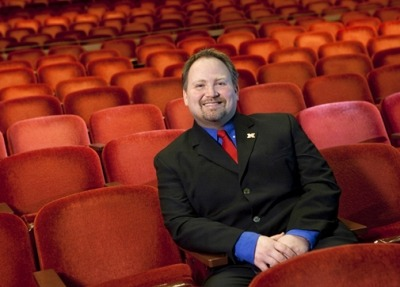 Image of Bill Stephan sitting in the iconic red seats of the Lied Center auditorium