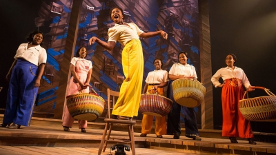 Image of the six women on stage in the Color Purple holding baskets