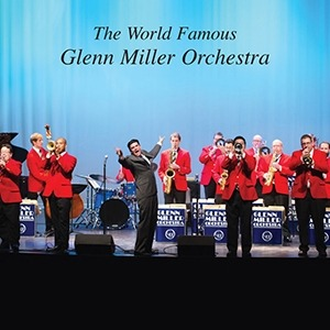 An image with several musicians from the Glenn Miller Orchestra being directed on a stage.
