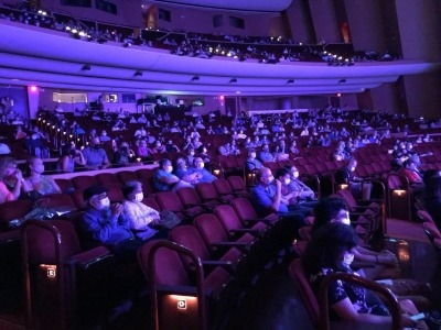 A socially-distanced audience fills the Lied Center.