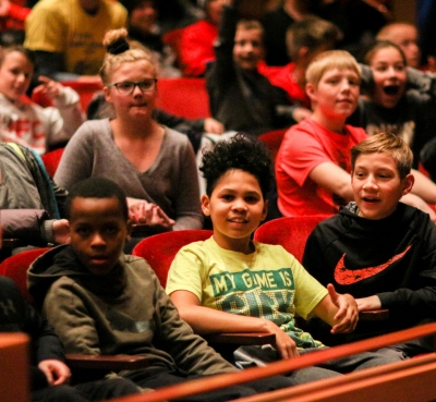 Image of children seated in the audience at a Lied Center performance