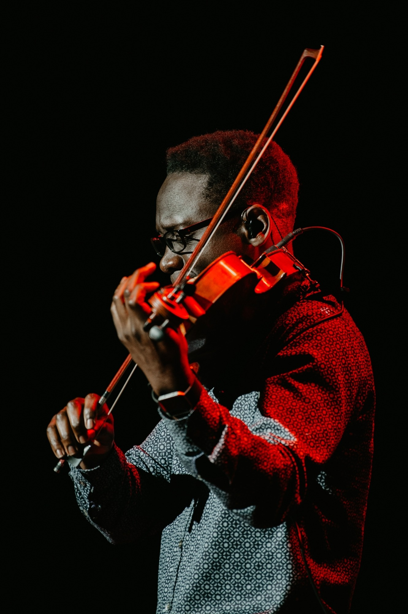 Image of one of the members of Black Violin playing his violin