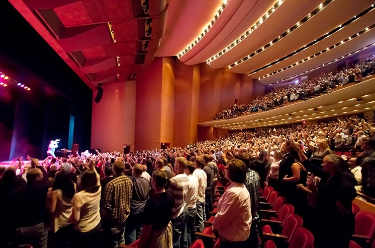 Image taken from the crowd of a full house for a Lied Center performance standing to applaud the performers