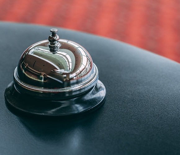 Image of a bell on a hotel counter