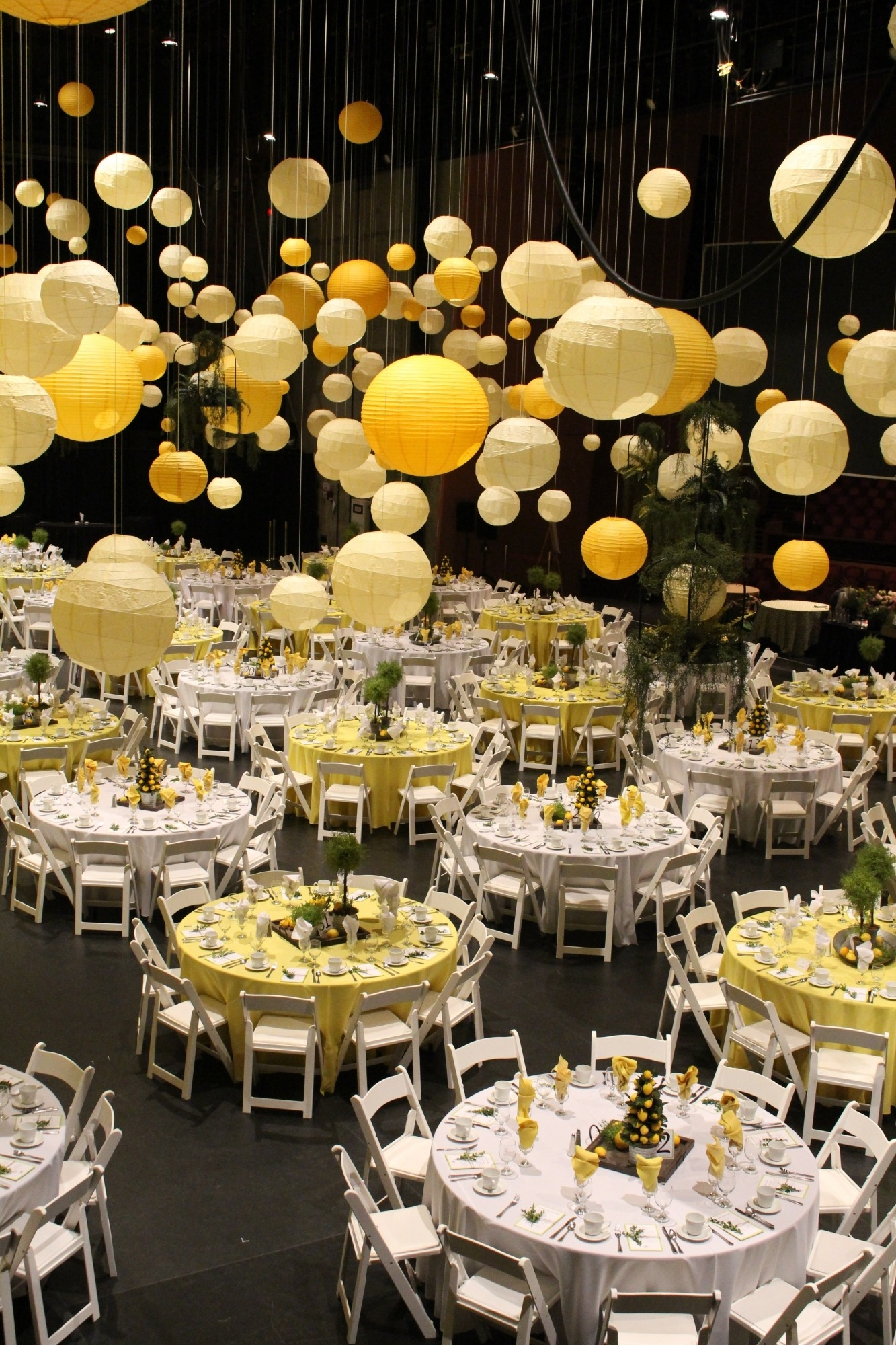 image of tables set up for a party with yellow balloons