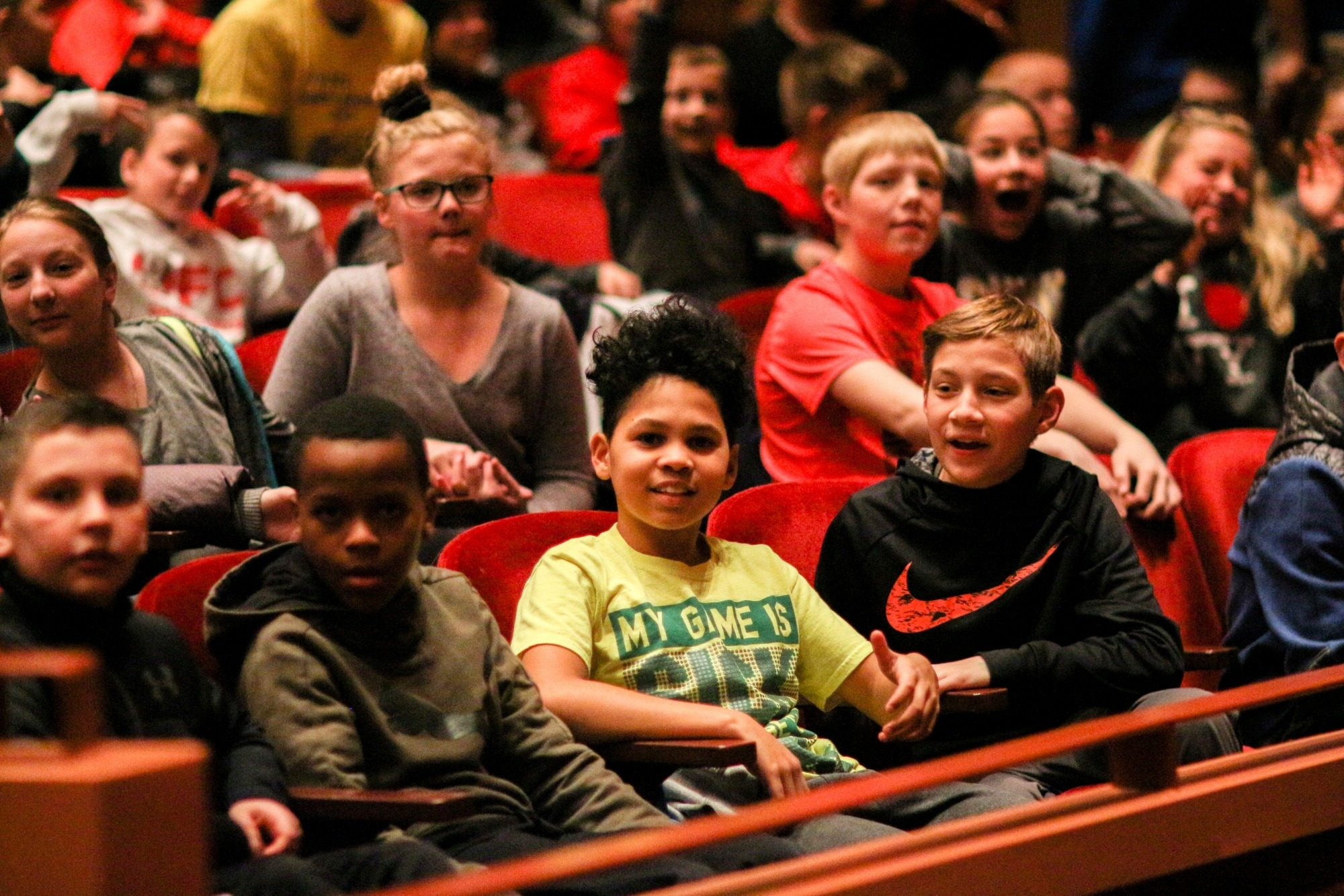 Image of young students sitting in the audience at the Lied Center