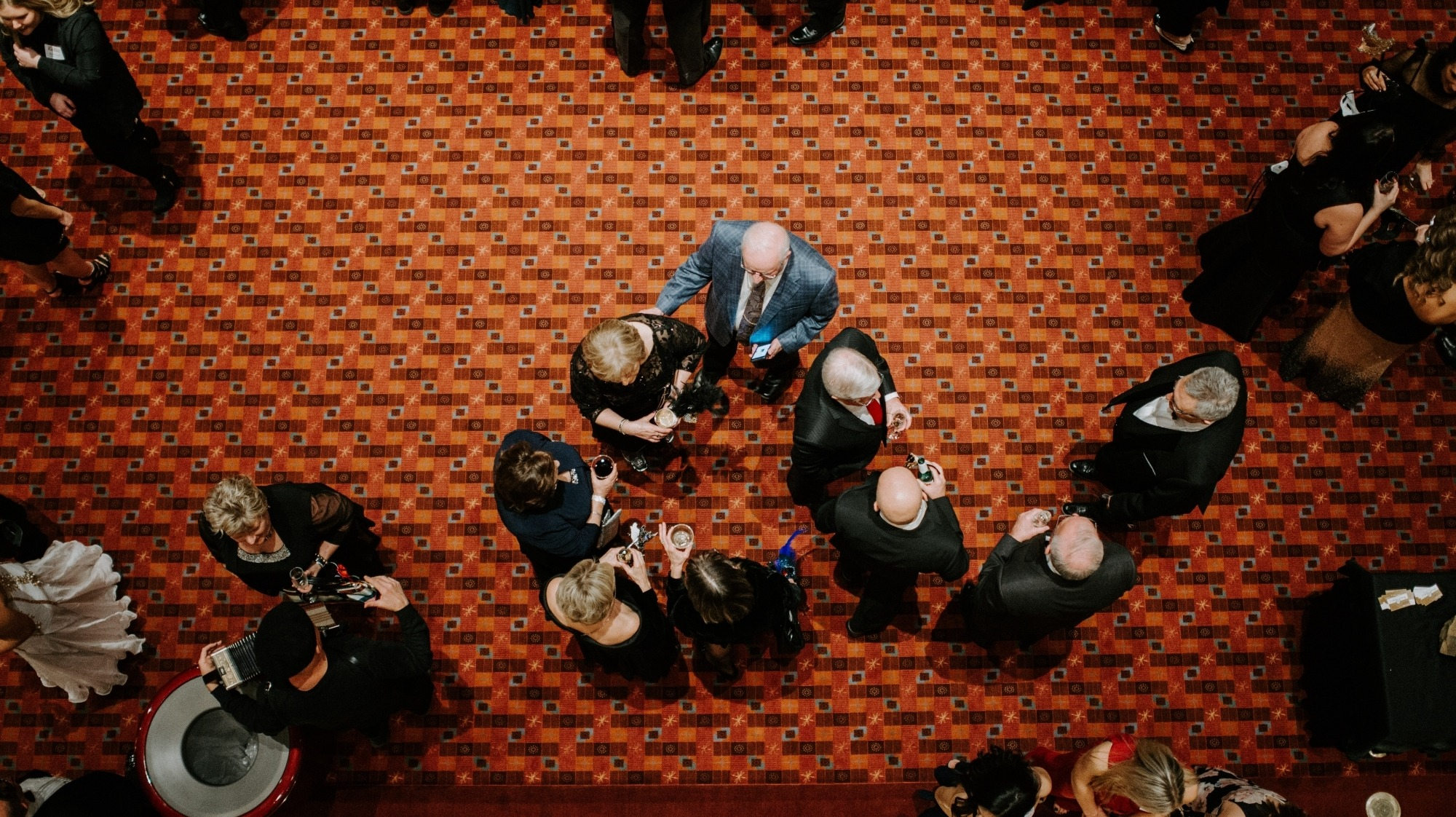 Image from above the Lied Center Orchestra Lobby showing patrons mingling and enjoying cocktails before the Friends of Lied Gala