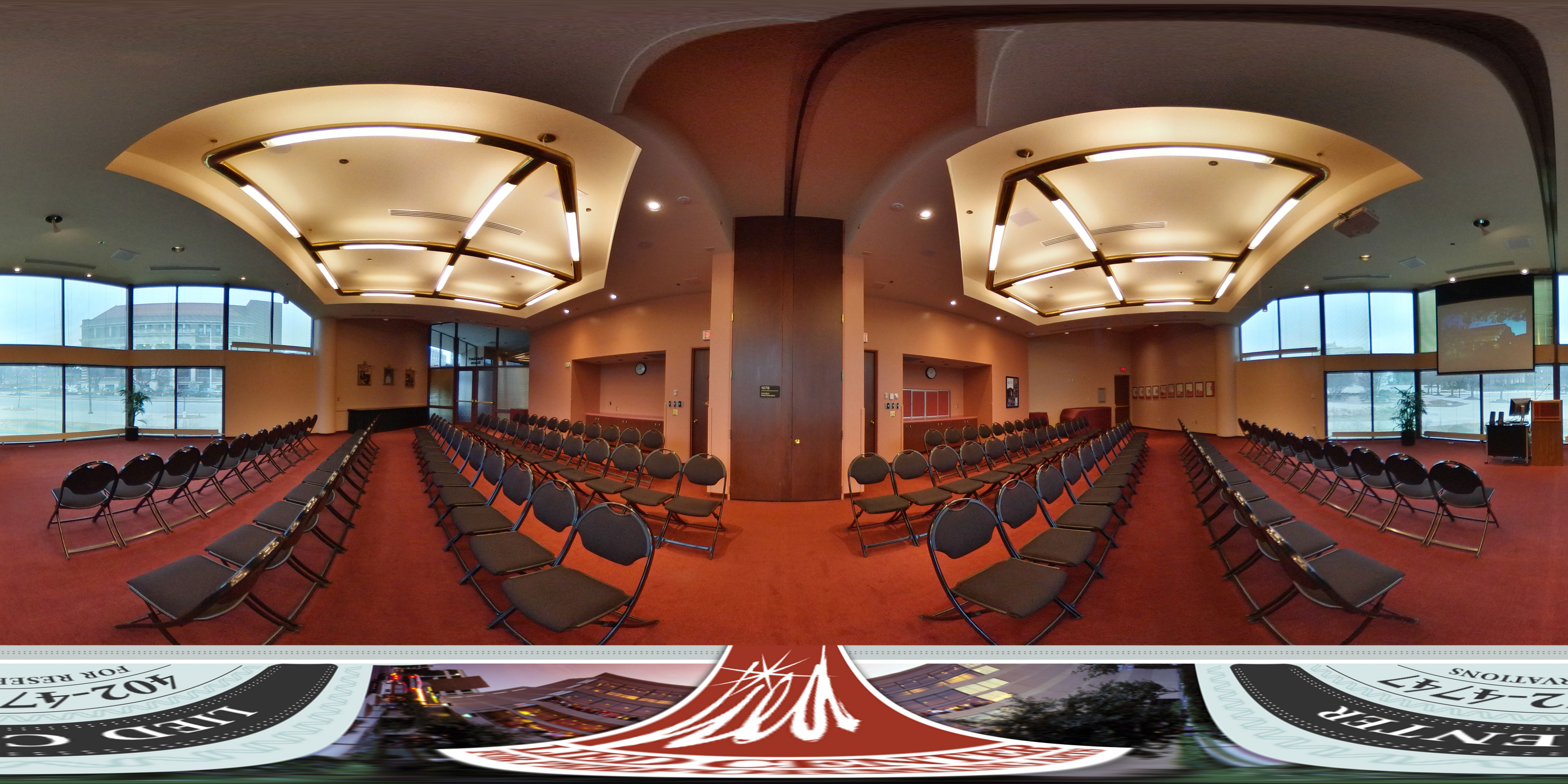 Virtual tour of the Lied Center Steinhart Room showing the view of the campus, projection screen and A/V cart, and the black chairs set up for a lecture.
